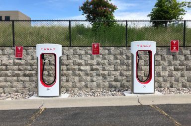 two-white-and-red-tesla-charging-station-2480315